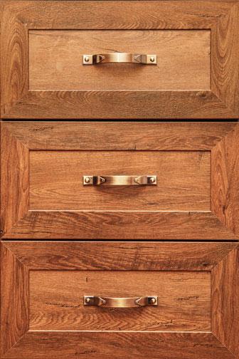 bronze drawer handles on three wooden drawers