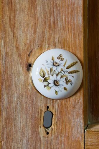 antique flowered doorknob wooden cabinet