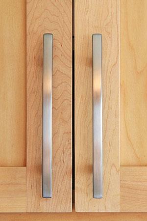 brushed silver door handles on maple cabinet doors