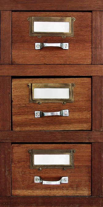 row of small drawers in an old furniture cabinet